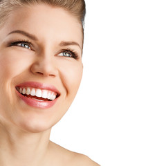 Portrait of pretty smiling woman with perfect white teeth.