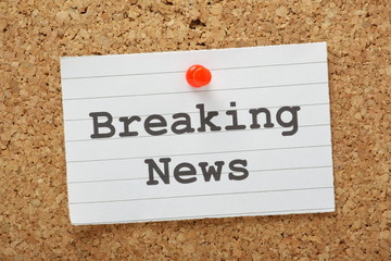 The phrase Breaking News on a cork notice board