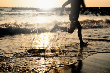 At the Sea - Running on the Beach at Sunset