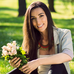 Woman smiling showing bouquet of flowers
