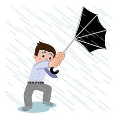突風で傘が壊れた男性