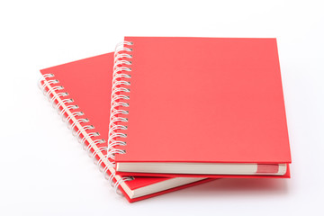 Stack of red color notebooks.