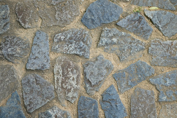 Granite Rocks Laid On Surface Of Pavement