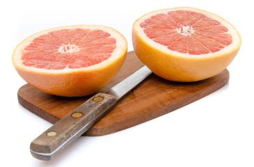 Grapefruit cut in half on a wooden board