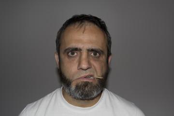 Man with a half his beard