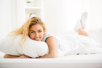 Woman resting in the bed