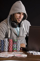 Frustrated poker player playing on laptop