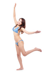 Happy young woman in sexy swimsuit