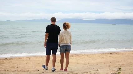 Young Couple Walking on Beach. Honeymoon.