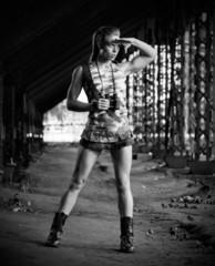 Woman in uniform with binoculars (monochrome version)