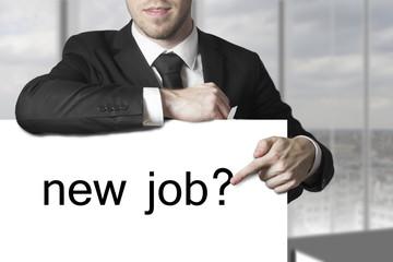 businessman pointing on sign new job hiring