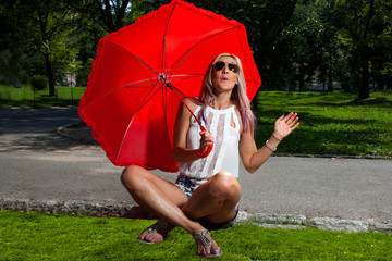 Young Blonde Athletic woman holding a Red Umbrella in Central Pa