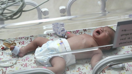 Crying newborn baby in Incubator care at nursery