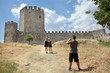 Tourists in Platamonas Castle Greece taking photos