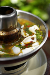 close up thai spicy squid soup in metal pot