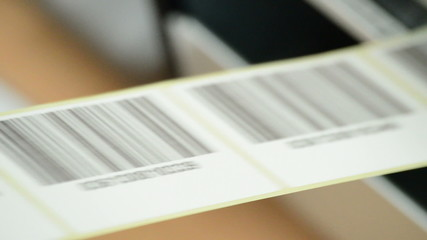 Barcode, label-generating machine in the foreground