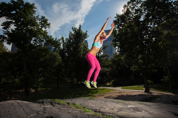 Young Woman posing and Exercising in Central Park, NYC on a beau