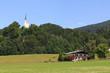 canvas print picture - Kirche und Haus in den Alpen