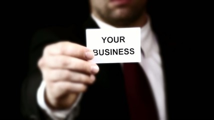 Businessman showing a card with text