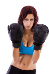 Beautiful healthy young girl with boxing gloves