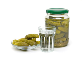 stack of Russian vodka and juicy pickles on a white background