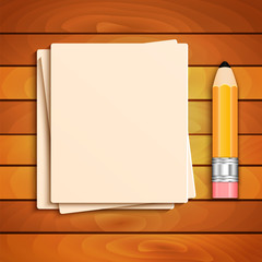 Pencil and a stack of paper sheets on a wooden table