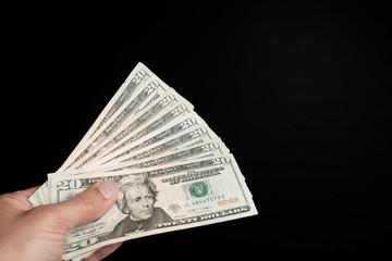 Hand voll Dollarscheine