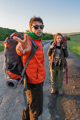 hitchhikers with backpacks