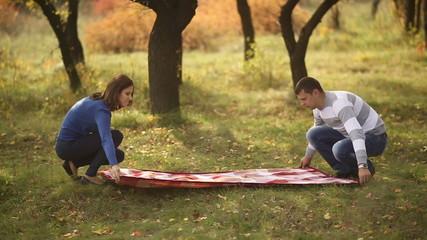 Couple Preparing for Picnic