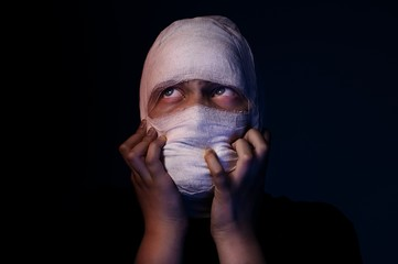 Infected sick girl with a bandage on her head