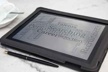 tablet with consulting word cloud