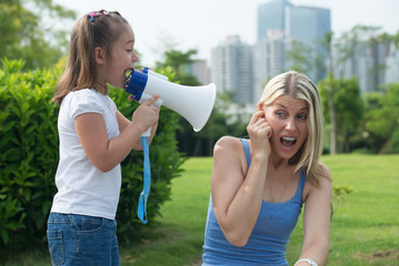 little girl shouting into a megaphone