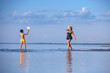 Young mother and son playing on the beach