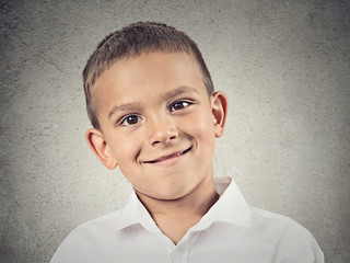 Headshot happy smiling boy, isolated on grey wall background