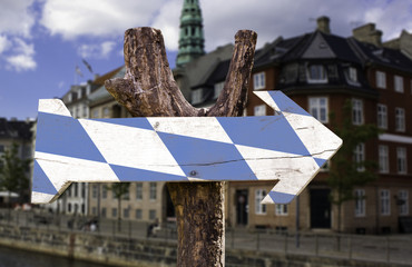 Bavaria wooden sign with a square on background