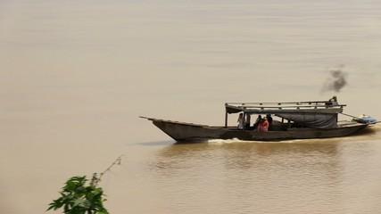 Small boat  across  Mekong  river (2)