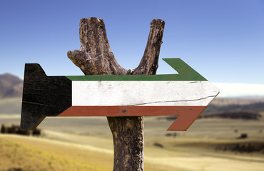 Kuwait wooden sign with a desert background