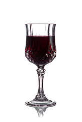 Red wine in a wineglass on a white background