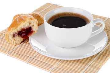 Cup of black coffee and a doughnut with strawberry jam