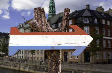 Luxembourg wooden sign isolated on a city on background
