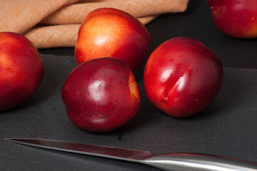 Fresh Nectarine Fruits On Slate Stone. Natural Linen Napkin