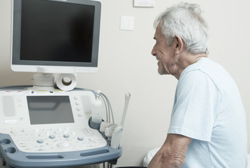 Happy senior male patient looking at medical results on a hospit