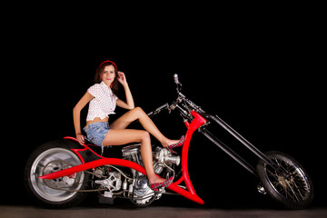 chopper styled motorbike with a beautiful pinup girl