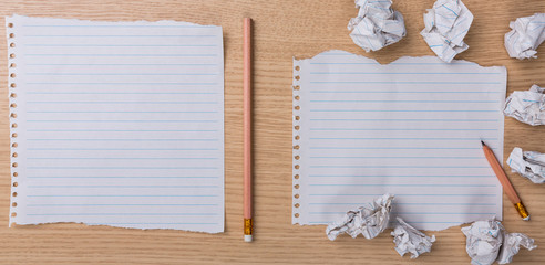 White note book paper with  pencil and crumpled on a wooden desk