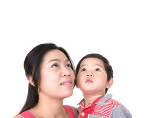 Happy mother holding  boy  looking up isolated on white backgrou