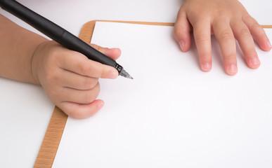 Preschool age child writing