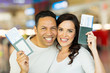 couple holding passport and boarding pass