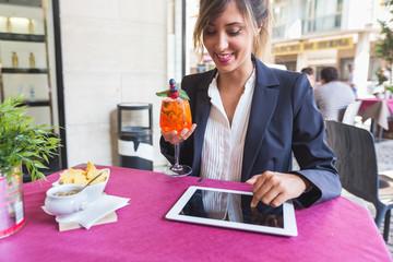 Young Businesswoman Having a Break at Bar