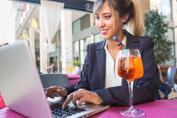 Young Businesswoman with Laptop during a Break