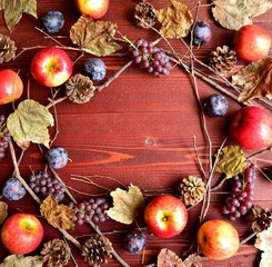 Autumn fruits with fall leaves